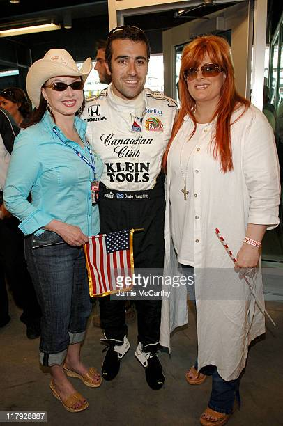 Naomi Judd Dario Franchitti and Wynonna Judd during Indianapolis 500 90th Running Race Day at Indianapolis Motor Speedway in Indianapolis Indiana...