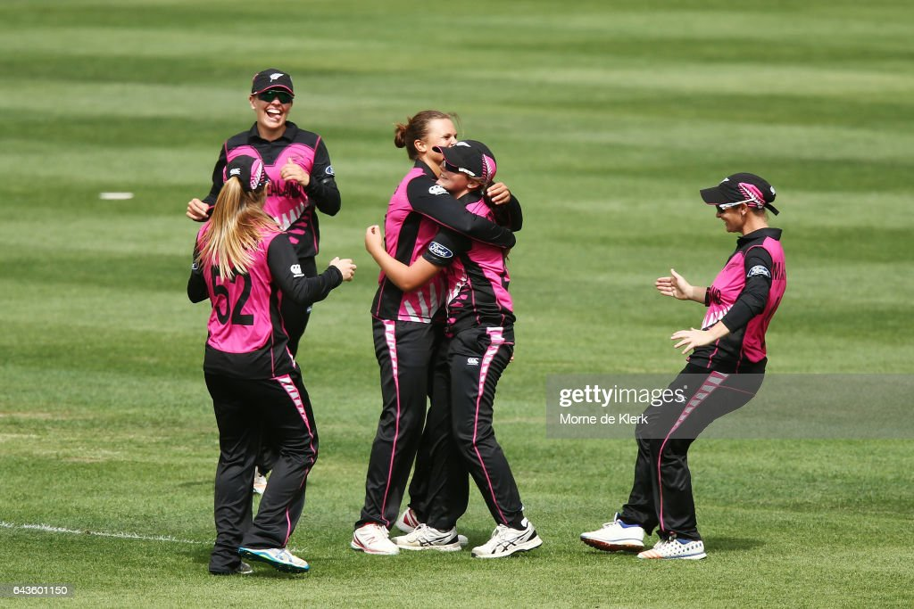 Naomi Kerr of New Zealand is congratulated by teammates after she took a catch to dismiss Alyssa Healy of Australia during the Women's Twenty20 International match between the Australia Southern Stars and the New Zealand White Ferns at Adelaide Oval on February 22, 2017 in Adelaide, Australia.