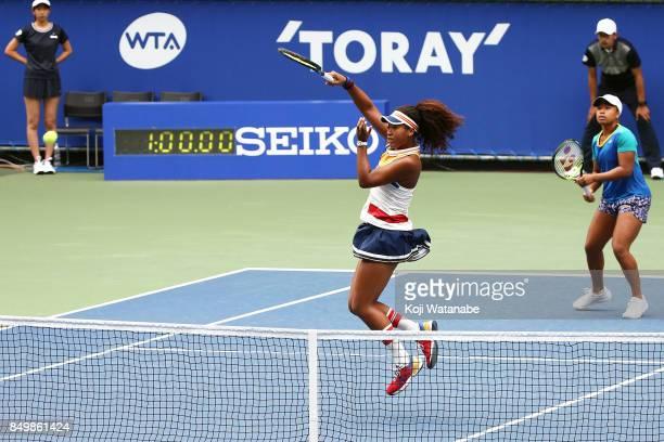 Naomi Osaka and Mari Osaka of Japan competes against Makoto Ninomiya of Japan and Renata Voracova of Czech Republic during women's doubles match day...