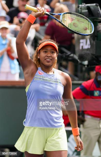 Naomi Osaka of Japan acknowledges the crowd after winning the women's singles final against Daria Kasatkina of Russia at the BNP Paribas Open in...