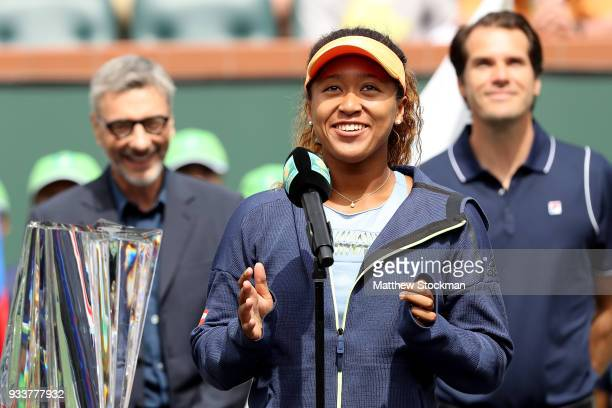 Naomi Osaka of Japan addreses the audiance at the trophy ceremony after defeating Daria Kasatkina of Russia during the women's final on Day 14 of the...