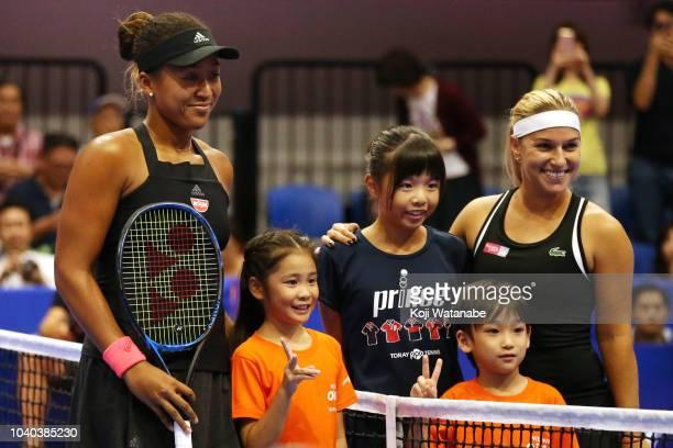 Naomi Osaka of Japan and Dominika Cibulkova of Slovakia pose prior to the Singles second round match on day three of the Toray Pan Pacific Open at...
