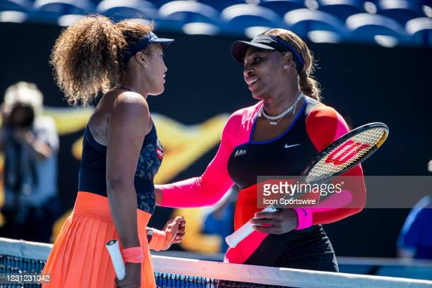 Naomi Osaka of Japan and Serena Williams of the United States of America embrace at the completion of their match during the semifinals of the 2021...