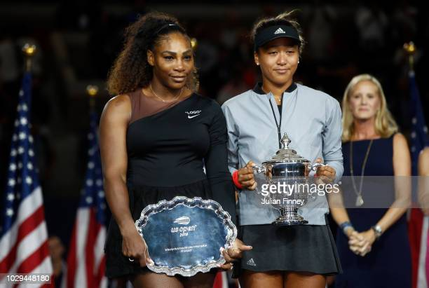 Naomi Osaka of Japan and Serena Williams of the United States pose their trophies after their Women's Singles finals match on Day Thirteen of the...