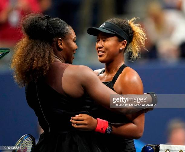 TOPSHOT Naomi Osaka of Japan and Serena Williams of the US meet at the net after their 2018 US Open women's singles final match on September 8 2018...
