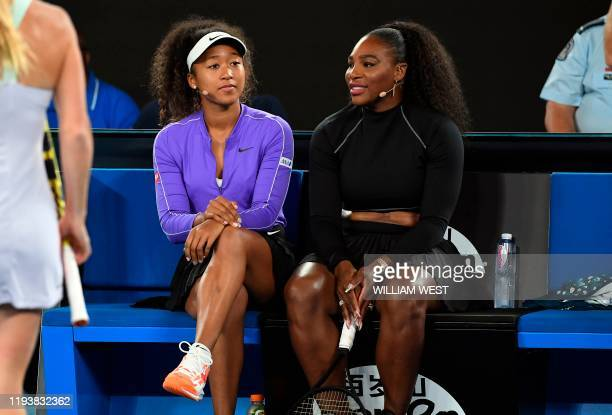 Naomi Osaka of Japan and Serena Williams of the US share a lighter moment as they and other top players play in the Rally for Relief charity tennis...