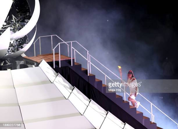 Naomi Osaka of Japan carries the torch to the Cauldron during the Opening Ceremony of the Tokyo 2020 Olympic Games at Olympic Stadium on July 23,...