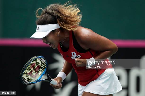 Naomi Osaka of Japan celebrates a point in her singles match against Heather Watson of Great Britain during day one of the Fed Cup World Group II...