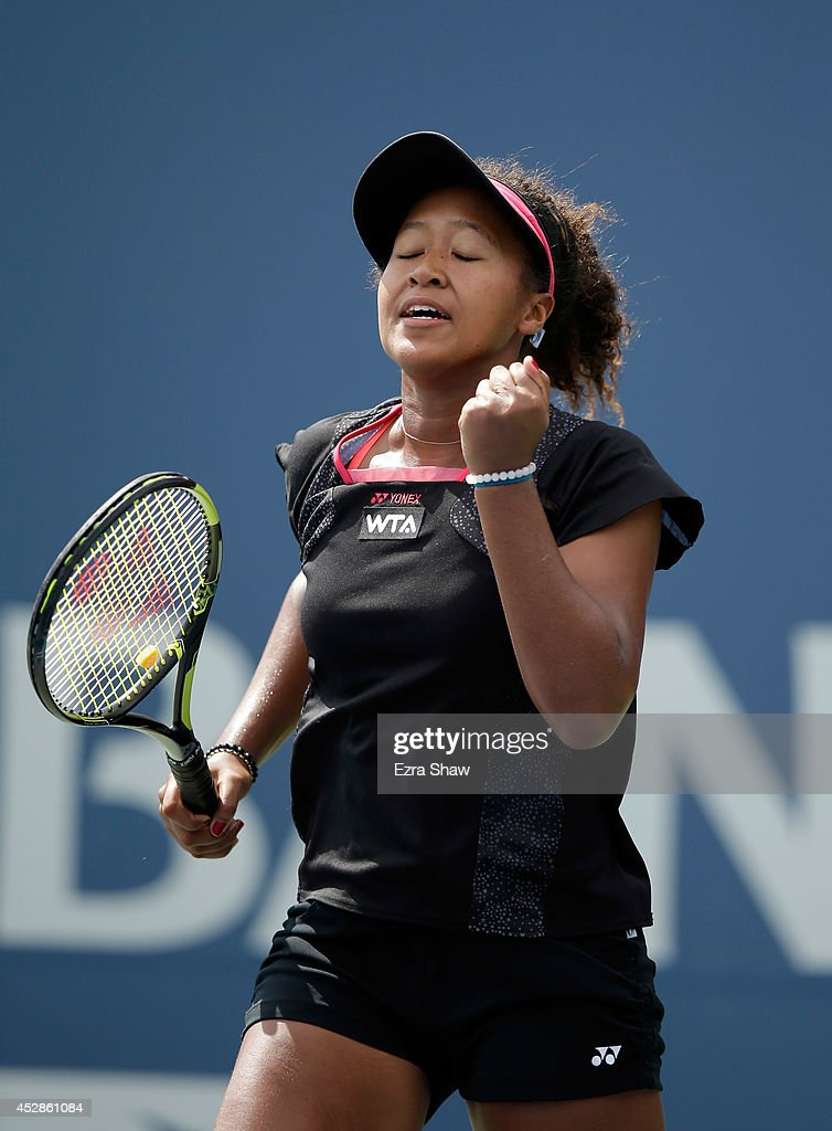 Naomi Osaka of Japan celebrates after beating Samantha Stosur of Australia during Day 1 of the Bank of the West Classic at the Taube Family Tennis Stadium on July 28, 2014 in Stanford, California.