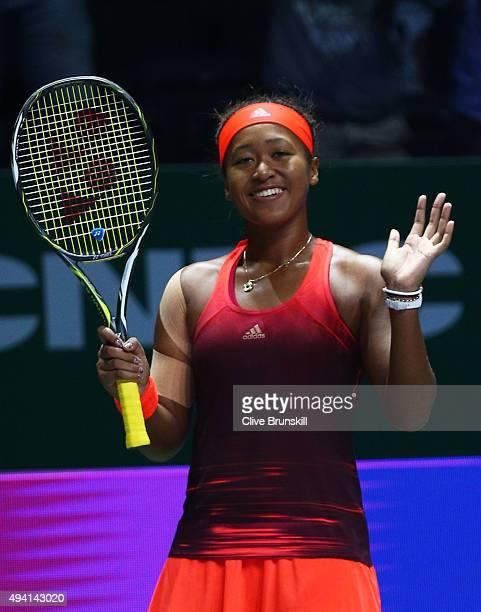 Naomi Osaka of Japan celebrates after defeating Caroline Garcia of France during the WTA Rising Stars Final at Singapore Sports Hub on October 25...
