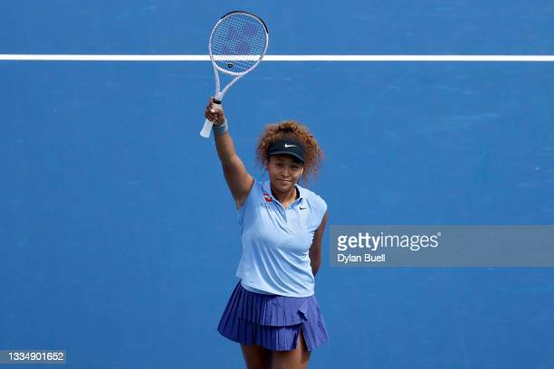 Naomi Osaka of Japan celebrates after defeating Cori Gauff 6-4, 3-6, 6-4 during Western & Southern Open - Day 4 at Lindner Family Tennis Center on...