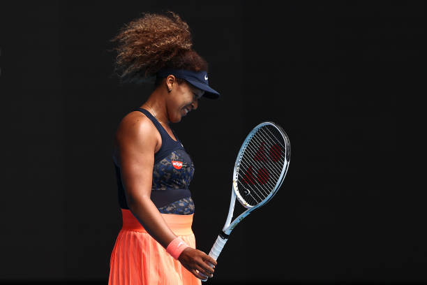 Naomi Osaka of Japan celebrates after winning match point in her Women's Singles fourth round match against Garbine Muguruza of Spain during day...