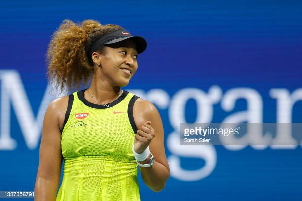 Naomi Osaka of Japan celebrates against Marie Bouzkova of the Czech Republic during their Women's Singles first round match on Day One of the 2021 US...