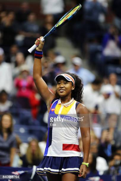 Naomi Osaka of Japan celebrates defeating Angelique Kerber of Germany in their first round Women's Singles match on Day Two of the 2017 US Open at...