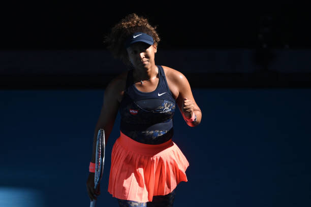 Naomi Osaka of Japan celebrates her victory over Ons Jabeur of Tunisia during day five of the 2021 Australian Open at Melbourne Park on February 12,...