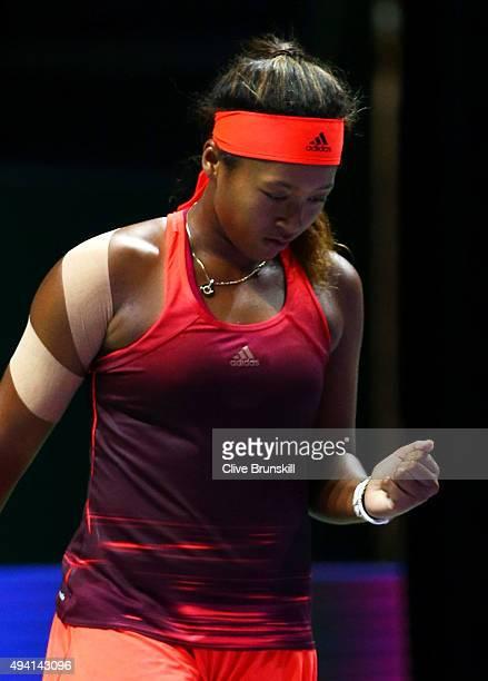 Naomi Osaka of Japan celebrates match point against Caroline Garcia of France during the WTA Rising Stars Final at Singapore Sports Hub on October...