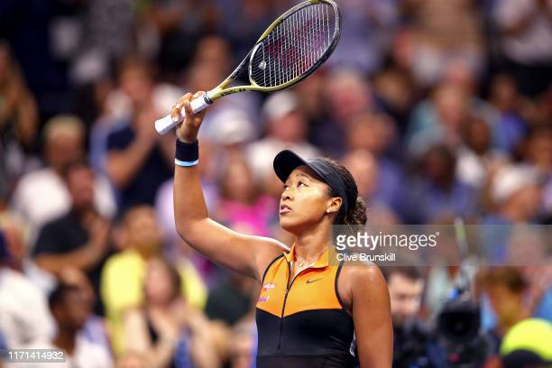 Naomi Osaka of Japan celebrates winning after her Women's Singles third round match against Cori Gauff of the United States on day six of the 2019 US...