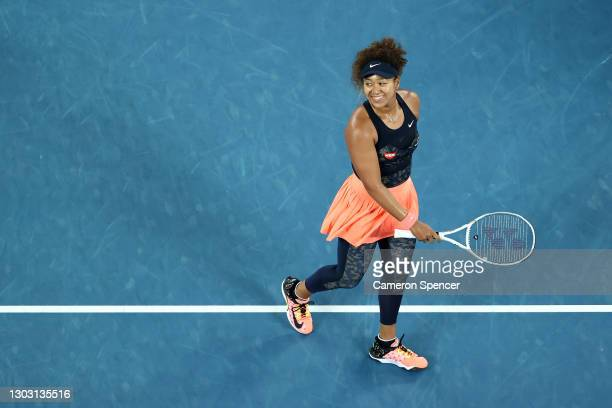 Naomi Osaka of Japan celebrates winning championship point in her Women's Singles Final match against Jennifer Brady of the United States during day...