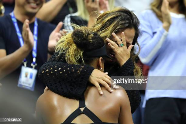 Naomi Osaka of Japan celebrates winning the Women's Singles finals match against Serena Williams of the United States with her mom Tamaki Osaka on...