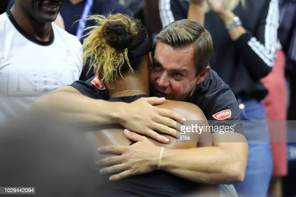 Naomi Osaka of Japan celebrates winning the Women's Singles finals match against Serena Williams of the United States with her coach Sascha Bajin on...