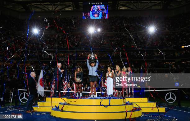 Naomi Osaka of Japan celebrates with the championship trophy after winning the Women's Singles finals match against Serena Williams of the United...