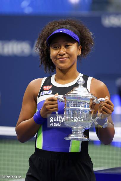 Naomi Osaka of Japan celebrates with the trophy after winning her Women's Singles final match against Victoria Azarenka of Belarus on Day Thirteen of...