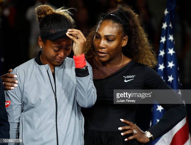 Naomi Osaka of Japan cries after winning the Women's Singles finals match alongside runner up Serena Williams of the United States on Day Thirteen of...