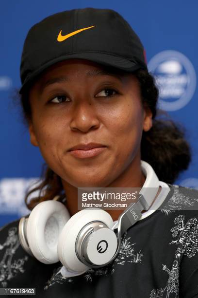 Naomi Osaka of Japan fields questions from the media at the WTA All Access Hour during the Western Southern Open at Lindner Family Tennis Center on...