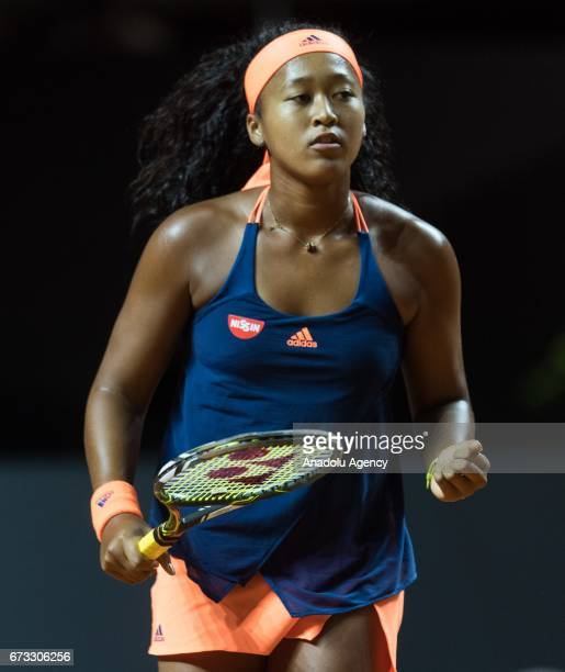 Naomi Osaka of Japan gestures in her match against Johanna Konto of Great Britain during the Porsche Tennis Grand Prix at Porsche Arena in Stuttgart...