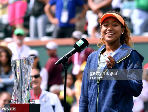 Naomi Osaka of Japan gives a speech with the trophy after her victory in the WTA final over Daria Kasatkina of Russia with her coach Sascha Bajin...