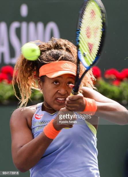 Naomi Osaka of Japan hits a backhand during her 63 62 win over Daria Kasatkina of Russia in the women's singles final of the BNP Paribas Open in...