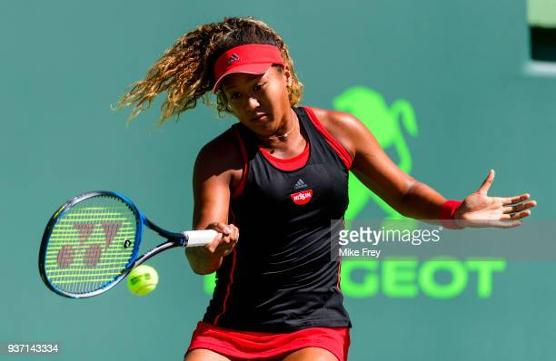 Naomi Osaka of Japan hits a forehand to Elina Svitolina of Ukraine during Day 5 of the Miami Open Presented by Itau at Crandon Park Tennis Center on...