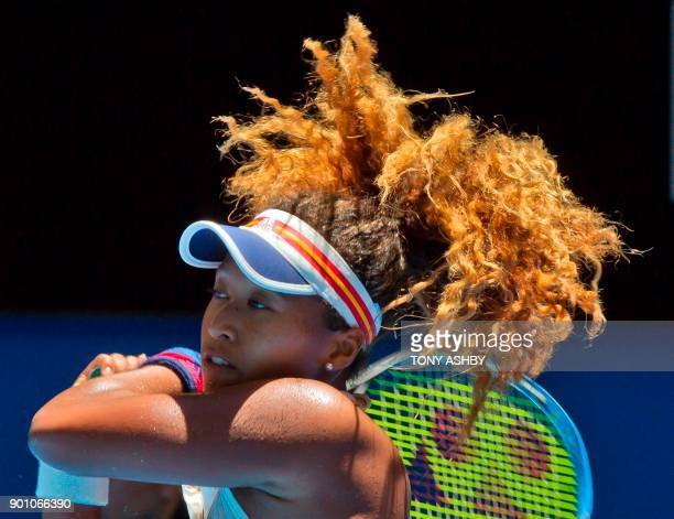 TOPSHOT Naomi Osaka of Japan hits a return against Anastasia Pavlyuchenkova of Russia during their ninth session women's singles match on day six of...