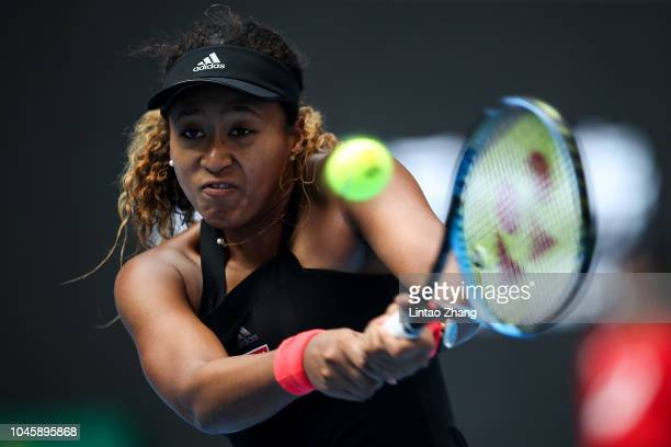 Naomi Osaka of Japan Hits a return during her Women's Singles Quarterfinals match against Zhang Shuai of China in the 2018 China Open at the China...