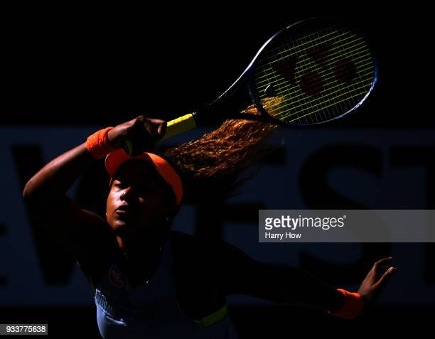 Naomi Osaka of Japan hits a return in her victory in the WTA final over Daria Kasatkina of Russia with her coach Sascha Bajin during the BNP Paribas...