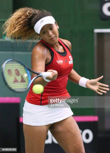 Naomi Osaka of Japan hits a return to Johanna Konta of Britain during their Fed Cup World Group II playoff women's singles match in Miki Hyogo...