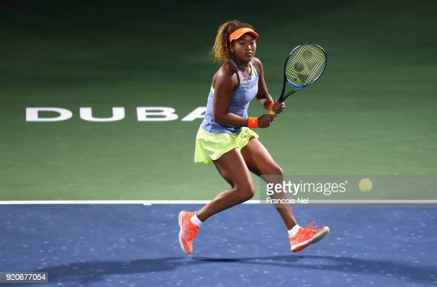 Naomi Osaka of Japan in action against Kristina Mladenovic of France during day one of the WTA Dubai Duty Free Tennis Championship at the Dubai...