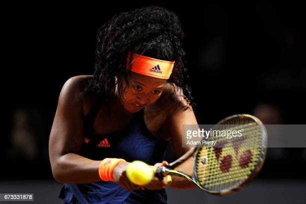 Naomi Osaka of Japan in action during her match against Johanna Konta of Great Britain during the Porsche Tennis Grand Prix at Porsche Arena on April...