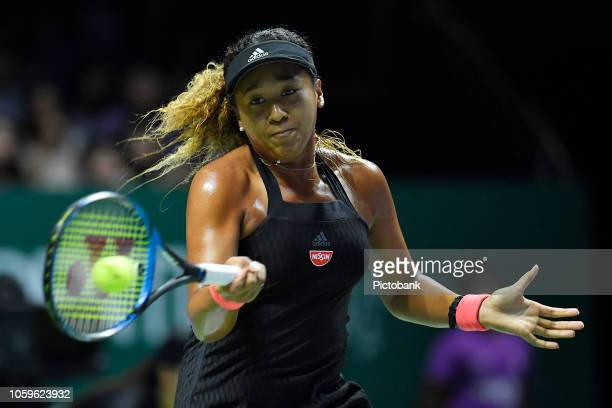 Naomi Osaka of Japan in action in her singles match against Kiki Bertens of the Netherlands during Day 6 of the BNP Paribas WTA Finals Singapore...