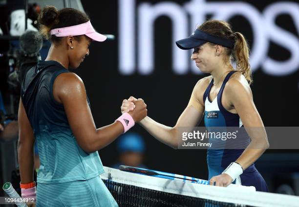 Naomi Osaka of Japan is congratulated by Magda Linette of Poland after their match during day two of the 2019 Australian Open at Melbourne Park on...