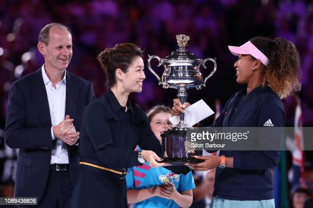 Naomi Osaka of Japan is presented with the Daphne Akhurst Memorial Cup from Li Na following victory in her Women's Singles Final match against Petra...