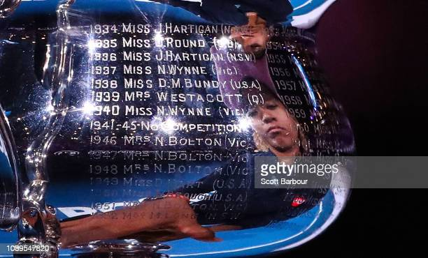 Naomi Osaka of Japan is reflected in the names of past winners as she holds the Daphne Akhurst Memorial Cup following victory in her Women's Singles...