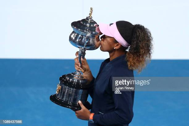 Naomi Osaka of Japan kisses the Daphne Akhurst Memorial Cup following victory in her Women's Singles Final match against Petra Kvitova of the Czech...