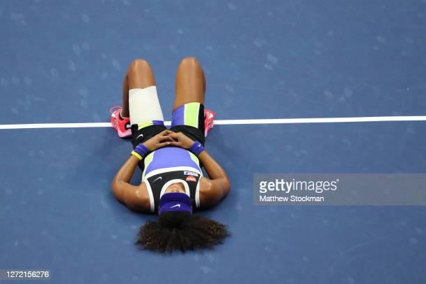 Naomi Osaka of Japan lays down in celebration after winning her Women's Singles final match against Victoria Azarenka of Belarus on Day Thirteen of...