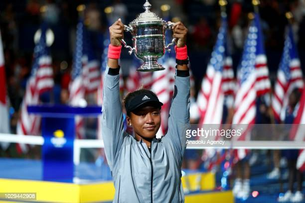 Naomi Osaka of Japan lifts her trophy after defeating Serena Williams of USA during the US Open 2018 women's final on September 8 2018 in New York...