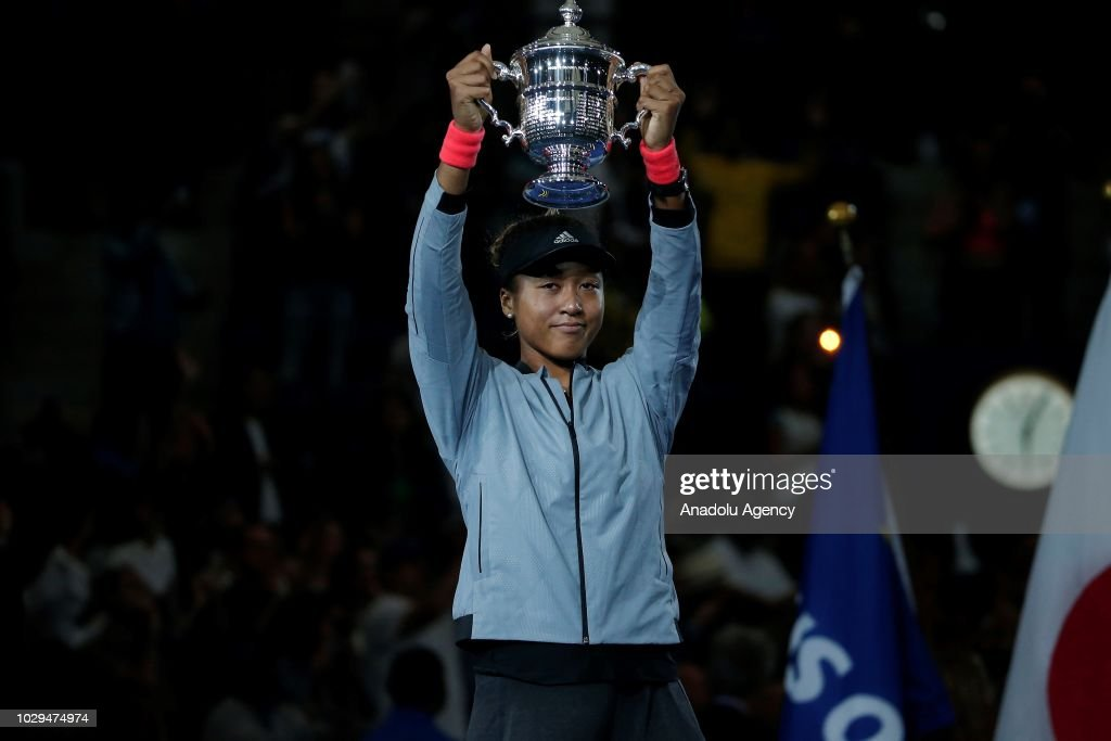 Naomi Osaka of Japan lifts her trophy after defeating Serena Williams (not seen) of USA during the US Open 2018 women's final on September 8, 2018 in New York, United States.