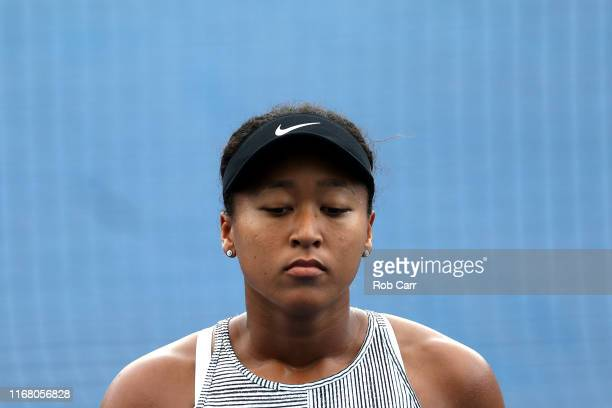Naomi Osaka of Japan looks on against Aliaksandra Sasnovich of Belarus during Day 5 of the Western and Southern Open at Lindner Family Tennis Center...