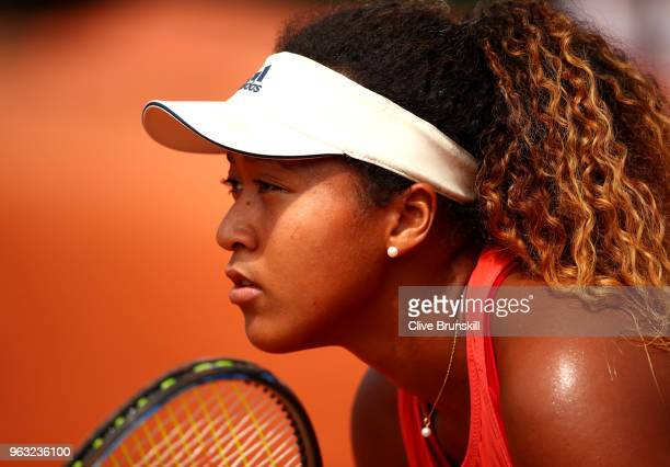Naomi Osaka of Japan looks on during the ladies singles first round match against Sofia Kenin of The United States during day two of the 2018 French...