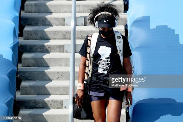 Naomi Osaka of Japan makes her way to the court for her semifinal match against Elise Mertens of Belgium during the Western Southern Open at the USTA...