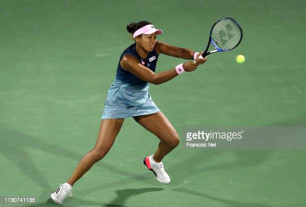 Naomi Osaka of Japan plays a backhand against Kristina Mladenovic of France during day three of the WTA Dubai Duty Free Tennis Championships at Dubai...